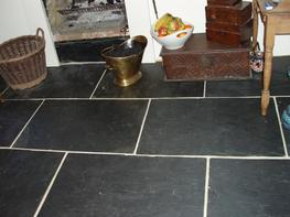 Slate is a fine-grained metamorphic rock produced around 375 million years ago from clay under compression. When it was formed the clay flakes formed 'layers' perpendicular to the pressure. When expertly cut by striking parallel to the layers with speciali...