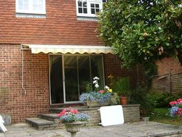 Classic retractable value patio awning - Deans Blinds & Awnings UK Ltd