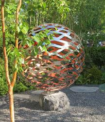 The Filium stainless steel garden sphere is made from a swirling mist of vine-like mirror polished stainless steel.  The interior is painted and can be any colour. On this page, the Filium has orange and hot pink interiors.  Extraordinary shadows and illuminat...