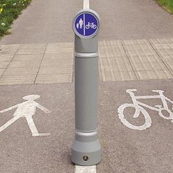 The mini-ensign bollard is a sign carrying bollard with a wide range of signface options such as cycle routes or directional arrows. Slimline and either passively safe, rebound or rigid options make this bollard ideal for in carriageway cycle lane initiatives....