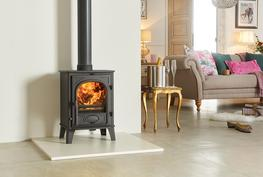The superb combination of size and heating capacity make the Stovax Stockton 6 wood burning and multi-fuel stove particularly versatile. It is produced as a wood burning stove (easily adapted to multi-fuel use with the optional riddling grate kit) or as a dedicated multi-fuel version with external riddling.  Alternatively, you can choose the multi-fuel Stockton 6 Highline stove – a version that provides an impressive focal point in kitchens and open plan rooms. All models also accept the optional 'clip-in' steel boiler. This will provide an abundant supply of domestic hot water during the winter months.