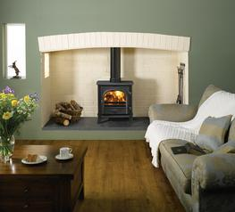 """The larger, but perfectly proportioned dimensions of the Stovax Stockton 7 wood burning and multi-fuel stove make it an ideal choice for grander rooms. With significant heating potential of up to 7kW, it is easily capable of providing warmth and ambience to even the loftiest of spaces. Available as a multi-fuel stove or a dedicated woodburner, the Stockton 7 can take logs up to 12¾"""" (325mm) in length meaning less work is required to prepare the fuel for your stove."""