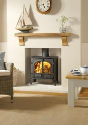 """The Stovax Stockton 8 wood burning and multi-fuel stove offers you greater choice and more optional features than any other model. There is also a space saving Stockton Slimline stove version which is 3"""" (75mm) shallower. Choose from a single or two door mod..."""