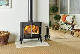 With an impressive 11kW heat output, this is the largest wood burning and multi-fuel stove in Stovax's Stockton range and is particularly suitable for sizeable living rooms, substantial inglenooks and open-plan barn conversions. The choice of flat top, low or high canopy, single or double door versions and four colour options, will provide you with the perfect combination for your home. The Stockton 11 is available as a dedicated woodburner which can be easily adapted to multi-fuel use with the optional riddling grate kit.