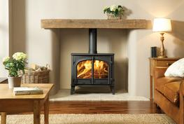 The impressive Stockton 14 is the largest and latest model in Stovax's much revered Stockton stove range. With the same notable features as its existing boiler equivalent, the Stockton 14 wood burning stove benefits from modern traditional styling for versatility and classic appeal.  With a heat output of up to 14kW, the Stockton 14 is ideally suited to larger inglenooks or to more extensive open living spaces.  It is available with either a flat top or high canopy as well as a choice of subtle colour finishes.