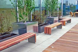 The Wood Bloc bench is a very heavy-duty wooden street bench with a modern design. Its generously proportioned FSC® timber slats are suspended above the surface level on a stainless steel frame to prevent ground level rot and enable easy part replacement....