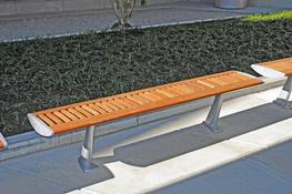 We took inspiration from a wing's aerofoil shape for the wood Foil bench's striking and dynamic design. The bench is free-draining and made from FSC® timber with a hidden stainless steel sub frame and cast aluminium end details. This free-standing bench i...