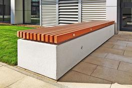The concrete Soca bench offers space defining, comfortable seating all year round. It features profiled FSC® timber slats suspended over a solid concrete base. This piece of street furniture lends itself to situations where an attractive vehicle deterrent is ...