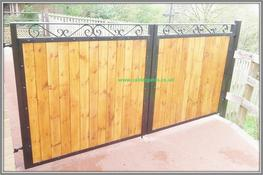 Sherwood metal driveway gate with wood infill image