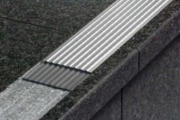 Schlüter®-TREP-E is a stainless steel stair nosing profile with a special non slip tread to create safe and attractive stair edges. The profile can be integrated into stairs covered with tile or natural stone, as well as into a screed or surface coating that...