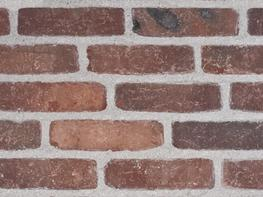 Unsanded moulded brick with a rustic look.           SIZE  ca. 212 x 101 x 65 mm (L x W x H)