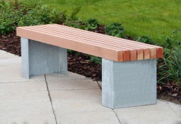 The Langley Bench LBN107 has a vertical slatted bench top and steel plinth type legs. The chunky steel C shape legs can be fixed down below finished grade or direct to surface and give the impression of a heavier plinth mount but without the weight. The legs c...