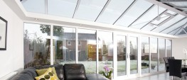 Specially designed for conservatories and large glazed areas, Pilkington Activ SunShade™ is perfect for use in both the roof and verticals. It uses daylight and rainwater to break down and wash away organic dirt from exterior surfaces, making it ideal for hard-to-clean areas. Typically the Blue is used in the roof and the Neutral in the verticals of a conservatory giving you a year-round clearer view of your garden. Its unique solar control coating also helps keep internal temperatures cool whilst still maintaining excellent light transmittance. For optimum thermal performance, combine Pilkington Activ SunShade™ with a product from the Pilkington K Glass™ or Pilkington Optitherm™ Ranges in an Insulating Glass Unit (IGU).