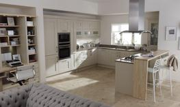 Milbourne is a classic shaker door with a chunky frame and a subtle textured finish. The Almond finish is an easy going neutral and this kitchen really is the all in one cooking, working and relaxing space....
