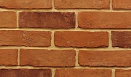 Farmhouse Orange is a high quality orange/red blended handmade brick with a textured appearance and some creasing on the face.