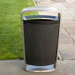 Collect Litter Bin and a companion recycling unit share a distinctive profile and provide basic function with surprising flair. As part of the Metro40 range, the litter bin features a cast aluminium ribbon frame, wide at the top and tapering toward the base, t...