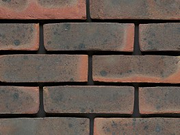 Stock brick (65mm), multicoloured with a sandfaced texture....