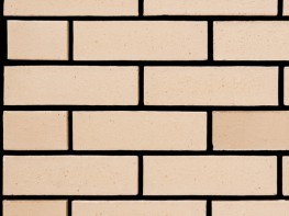 Wirecut brick (65mm), buff in colour with a smooth texture....