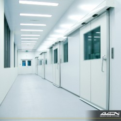 Hermetically sealed sliding doors from Gilgen Door Systems are designed for sensitive environments where hygiene along with thermal or acoustic insulation are indispensible requirements. Typical applications for our SLX-D hermetically sealed doors include hospital clean-rooms, surgeries and isolation areas, clinics or food production facilities and chemical or pharmaceutical industries. Our patented pivoting mechanism automatically seals the door preventing unwanted exchange of foreign particles and impurities. 