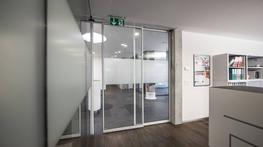 The Gilgen SLX/PSA slimline automatic sliding door system has delicately shaped door profiles ideal for design conscious environments and is suitable for internal doors and less intensive external entrances. The PSA profile system protects the glass and convinces with its impressively slim profile and high level of robustness. Thanks to the slim profile, this door is suited for interior use. 