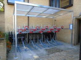 The Cyclepods Cambridge is a Stylish and versatile shelter perfect for all buildings; capable of sheltering up to 24 bikes! In our EasyLift+ Two tier system Extension units can be added to form a larger shelter and house more bikes.