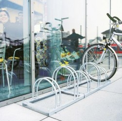 Cycle rack features:  •Strong steel construction cycle rack. • Hot Dip Galvanised for long life. • Tyre widths up to 55mm. • Accessible from one or two sides. • Easy self assembly.  Specifications: Size: 415mmH x 390mmD x 350mm between wheel...