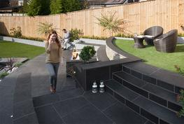 Combining fantastic strength and technical consistency, the Symphony range is a great choice for customers needing flags that look great and stay looking great. Symphony is a vitrified paving material, meaning that it absorbs little or no moisture, offering few opportunities for moss and algae to grow.  Available in a range of authentic appearances and textures; Symphony paving promotes a stylish and contemporary appearance that will appeal to homeowners of all property types.  For 2016, Symphony Vitrified Paving is available in eleven colours and several finishes including the new plank paving that perfectly recreates the colours and textures of wooden planks.