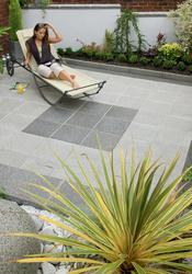 The ultimate in contemporary cool, Argent smooth garden paving boasts a beautiful blend of British granite aggregates giving a modern sophisticated look to your patio. The different shades and textures available lend themselves well to bold geometric paving patterns.  Argent possesses a surprising and subtle sparkle that the luxurious stone aggregates provide. The Argent range consists of matching contemporary walling, setts, ornamental feature and palisades for a complete co-ordinating garden design.