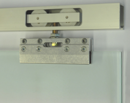 HAWA-Junior hardware system in combination with clamping shoe for all-glass sliding doors up to 40 kilograms) or 80 kilograms    The clamp mechanism of the HAWA-Junior 40-80/GS hardware system permits installation of all-glass sliding doors without glass cu...