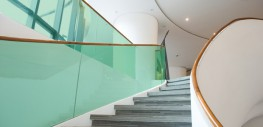 LamiGlass green uses a coloured interlayer rather than a clear interlayer to bond 2 or more pieces of glass....