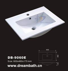 Product Name:Vanity Basin    Model No.: DB-9060E Dimension: 600X460X175mm  (1 inch = 25.4 mm)   Volume: 0.065CBM  Gross Weight: 14KGS  (1 KG   2.2 LBS) Basin shape: Rectangular   Vanity sink's features and detailed information as follows :  1. Material: ...