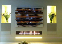 "Large, Landscape, Impressive. The 1500mm wide Fire Wave can create a stunning feature fireplace within a room or commercial property. The 13kw ribbon gas burner has a dramatic effect within the enclosure which is available in brushed, polished and black steel. The fire is operated by a fully sequential remote control and is supplied a as a fully built fireplace with gas burner, enclosure and gather unit. This makes installation easy. A double sided or ""see through"" version is available upon request."