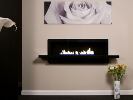 The Fire Break is a truly stunning fireplace of true quality. Manufactured from 50mm thick natural stone or hand polished bronze. The enclosure is 1200mm wide and is complimented by a 1500mm shelf. This is a large and glamorous gas fireplace that will complement both Contemporary and Traditional interiors. A hand-made Polished Bronze version is available upon request.