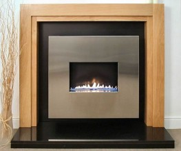 The CORONA features the ANGEL flueless gas fire set within a solid Oak fireplace surround. This high quality traditional gas fireplace design is supplied as a complete package including flueless gas fire, oak surround, black granite hearth and black satin back...