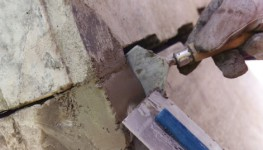 An epoxy crack injection grout comprising a base component containing solvent-free epoxide resin plus a low viscosity liquid hardener. Can be placed by free flow under gravity or may be injected using a suitable hand or mechanical pump. Grouting of gap dimensi...