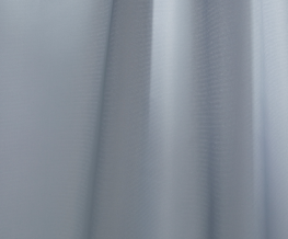 Designed by Maxjenny Forslund, Blue Hour is a flat, unicoloured curtain, which particularly stands out for its distinctive simplicity. Closely-woven yet slightly translucent, it has a defined, almost sculptural effect when draped. The yarns used in the constru...