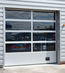 A glazed sectional overhead door, designed to be used when there is a need for light, exposure, or vision. Typical applications are show-rooms, fire stations, or other applications where optimal daylight inlet and/ or exposure possibilities are desirable.