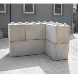A flexible and cost effective interlocking modular block retaining wall system which can be built up to achieve high retaining wall structures....