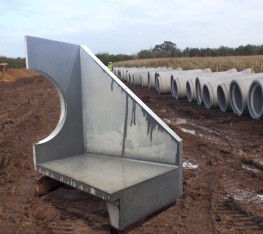 Precast concrete headwalls for drainage outfall connections into open water areas including collection ponds, swales and rivers.