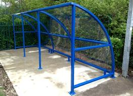 The Easydale is our most cost-effective buggy shelter because of its simple, yet stylish design. It is the perfect shelter solution for safe, secure storage for buggies and prams, keeping them protected from theft, vandalism and poor weather conditions.  This permanent shelter is constructed from a robust steel frame and is covered with 5mm solid polycarbonate roof panels which are available in clear or opal. Polycarbonate side panels are available on request at an additional cost. A standard shelter measures 4.1m x 1.7m and can be extended by 2m bays.  The Easydale is available complete with buggy bars which can be used with padlocks to secure the push chairs (padlocks are not included in the price).  Buggy shelters are perfect for creating a designated area for pram storage and they prevent other areas from becoming cluttered and hazardous due to unfastened prams. The Easydale Buggy Shelter is ideal for use in nurseries and pre schools, providing a secure space for parents and staff to store buggies during the day. This shelter is also perfect for use outside shops and restaurants, providing customers with an area to store pushchairs and buggies whilst visiting the establishment.  The Easydale Buggy Shelter is available galvanised and/or powder coated in a range of standard RAL colours, other non standard RAL colours are available on request.