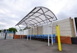 The Langdale Waiting Shelter is a robust, steel construction that provides cover using 5mm solid or 10mm structured polycarbonate panels. The Langdale is fitted using a unique clamping system on the edge of the shelter. These clamps dramatically reduce the need to drill holes therefore avoiding water leakage and bulging of the panels.  A freestanding Langdale Waiting Shelter has a maximum 3 metre width and is supplied with two double sided steel benches that can be powder coated or galvanised to any standard RAL colour of you choice to match your surroundings. Alternatively benches can be chosen from our Accessories range, which include the Burnside Bench (shown in some product images above).  All our waiting shelters are fitted by our fully trained installation teams who take great pride to ensure your shelter is fitted to your satisfaction.