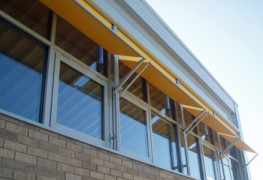 This external solar shading system consists of a range of options to cope with most glazing types. All metal components are made from aluminium or stainless steel and the fabrics used are highly durable, fade, stretch and weather resistant. Given the location of these solar shading devices they are typically operated by 240v electric motors which are fully contained in the roller barrel of the blind. Manual operation is also available. External blinds are typically better at reducing unwanted heat gain than internal solar shading.