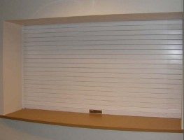Bolton Gate's range of Fireroll roller shutters are designed to provide compartmentation for smaller openings where its attractive close fitting lath curtain and concealed tubular motor make it eminently suitable for all applications but particularly servery t...