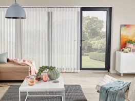 Utilising the Louvolite Slimline Vogue® or Allusion 80mm Fascia, Allusion blinds combine the delicacy of voile fabric with the versatility of rotating vertical louvres. Slide the soft fabric to the side for a clear view or just rotate the louvres for a light filtering view or complete privacy.  Choose from two stunning ranges; Horizon combines a woven texture and sheer in neutral calming tones while Vista is a flame retardant fabric with a subtle geo wave. The Allusion fabric sweeps elegantly across windows and doors, ideal for commercial and domestic spaces featuring balconies or needing room dividers as the vanes can be passed through effortlessly.  Blind operation includes:  - Chain or Cord - Monocommand Wand  All Louvolite roller systems comply with child safety regulations, are UK manufactured using prime quality materials and are 10 year life cycle tested to ensure top performance in a demanding environment.