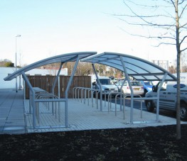 A superb looking and strong cycle shelter for all environments, the Cambridge is a free-standing single-sided solution for all locations. The frame is of robust, galvanised steel tube and section. Roof 10mm twin walled clear polycarbonate finish. 16 x 16mm fix...