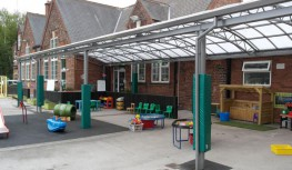 The barrel format brings the eaves down on either side creating greater protection in open areas. In Primary School outdoor play canopies, the trellis arches are used to hang sensory and tactile artwork and other decorative or informative items.  The Oxford ...