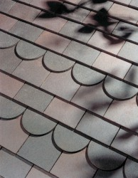 Blue Brindle and Dark Heather clay tiles are a predominantly blue colour, with subtle shade differences of lighter blue and purple hues....