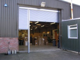 Integrated personnel door for roller shutters....