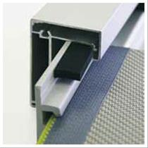 Roller blind for exterior solar shading with edge profiles and headbox.- Reduces solar heat gain when located externally.- Manual or electric operation.- Patented zip type edging to blind maintains contact in windy conditions and ensures insect exclusion wh...
