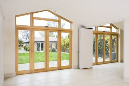 Marvin's high performance and energy efficient Aluminium Clad Wood Bi-Fold Doors have an extruded aluminium exterior finished to commercial grade. This top of the range product is maintenance free for 20 years plus and will sustain all weather conditions.